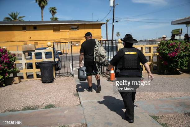 Maricopa County constable Darlene Martinez evicts a tenant on October 7, 2020 in Phoenix, Arizona. Thousands of court-ordered evictions continue...