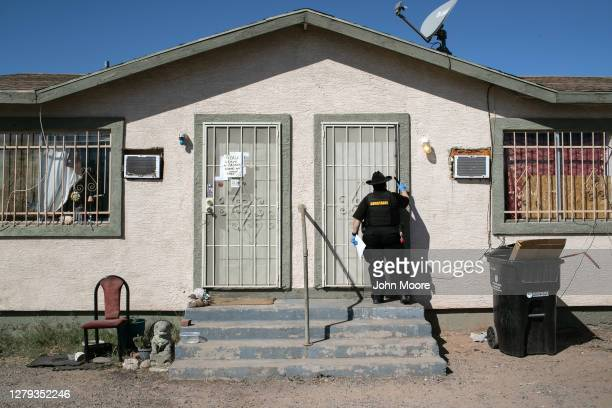 Maricopa County constable Darlene Martinez knocks on a door before posting an eviction order on October 1, 2020 in Phoenix, Arizona. Thousands of...