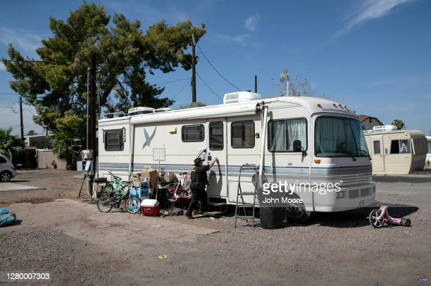 Maricopa County constable Darlene Martinez knocks on an RV to evict Hector Medrano and his family from their RV park on October 07, 2020 in Phoenix,...