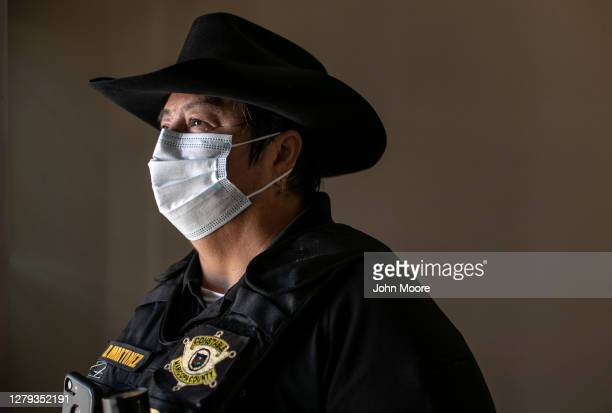 Maricopa County constable Darlene Martinez prepares to post an eviction order in an apartment on October 1, 2020 in Phoenix, Arizona. Thousands of...