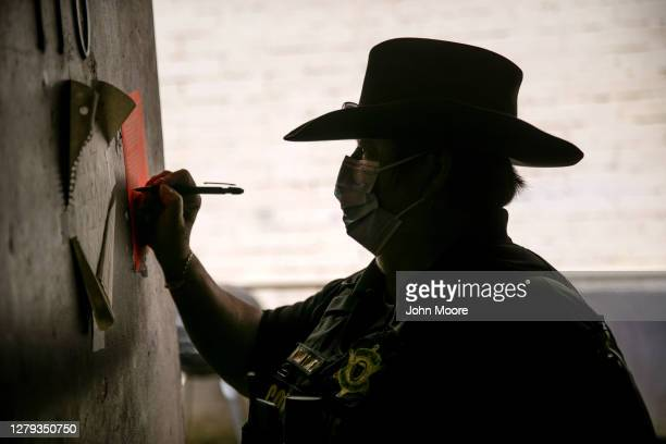Maricopa County constable Darlene Martinez signs an eviction order on October 7, 2020 in Phoenix, Arizona. Thousands of court-ordered evictions...