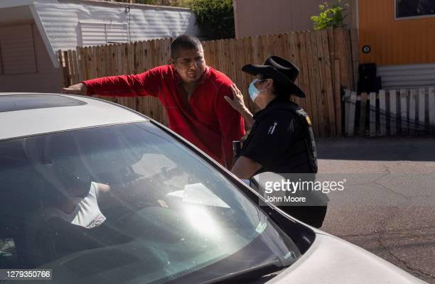 Maricopa County constable Darlene Martinez speaks with a tenant after serving an eviction order for non-payment of rent on October 7, 2020 in...
