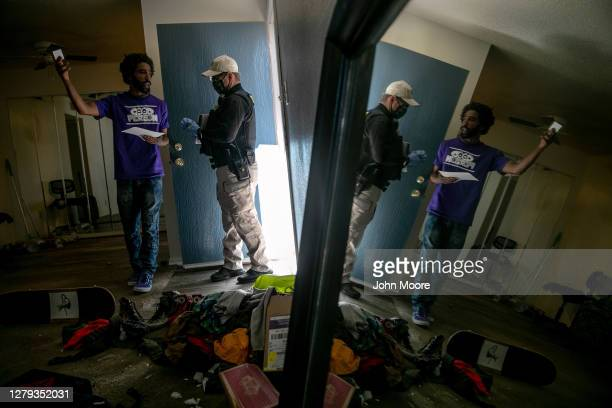 Maricopa County constable Lenny McCloskey evicts a tenant for non-payment of rent on October 6, 2020 in Phoenix, Arizona. Thousands of court-ordered...