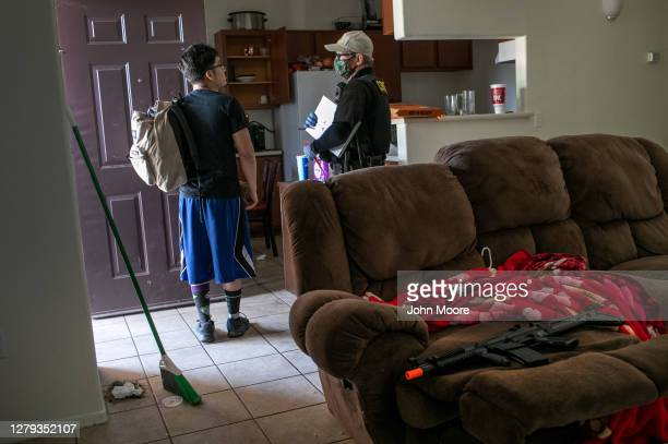 Maricopa County constable Lenny McCloskey evicts an apartment resident for non-payment of rent on October 5, 2020 in Phoenix, Arizona. Thousands of...
