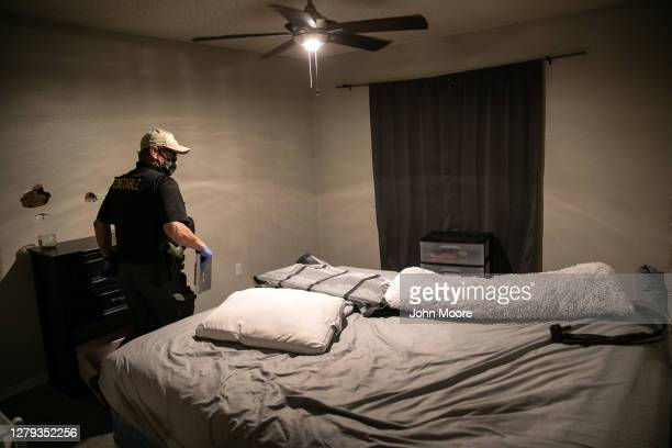 Maricopa County constable Lenny McCloskey inspects an apartment while serving a court eviction order on September 30, 2020 in Phoenix, Arizona....