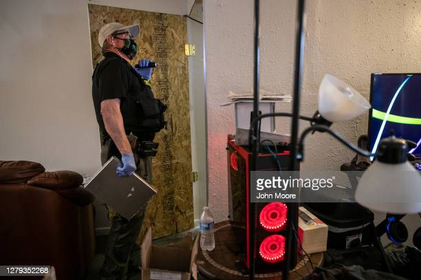 Maricopa County constable Lenny McCloskey inspects an apartment while serving an eviction order on September 30, 2020 in Glendale, Arizona. Thousands...