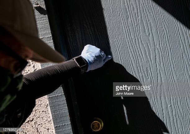 Maricopa County constable Lenny McCloskey knocks on an apartment door before evicting tenants for non-payment of rent on October 6, 2020 in Phoenix,...
