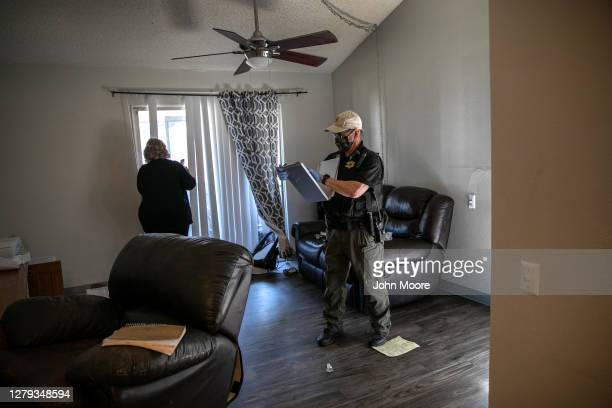 Maricopa County constable Lenny McCloskey serves a court eviction order in an apartment on September 30, 2020 in Phoenix, Arizona. Thousands of...