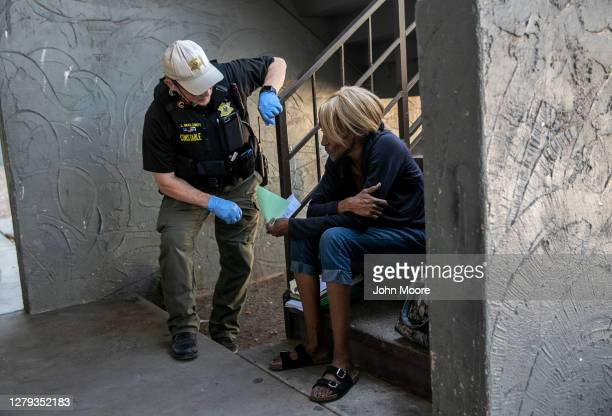 Maricopa County constable Lenny McCloskey speaks with a renter after evicting her from a hotel for non-payment on October 2, 2020 in Phoenix,...