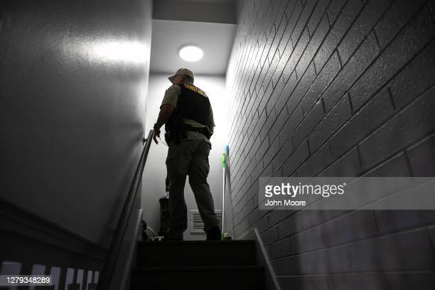 Maricopa County constable searches as apartment while serving an eviction order on September 30, 2020 in Phoenix, Arizona. Thousands of court-ordered...