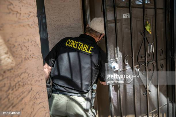Maricopa County constable serves a court eviction order at an apartment on September 30, 2020 in Phoenix, Arizona. Thousands of court-ordered...