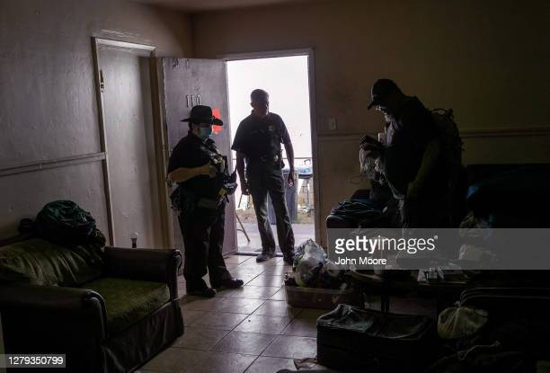 Maricopa County constables evict a renter on October 7, 2020 in Phoenix, Arizona. Thousands of court-ordered evictions continue nationwide despite a...
