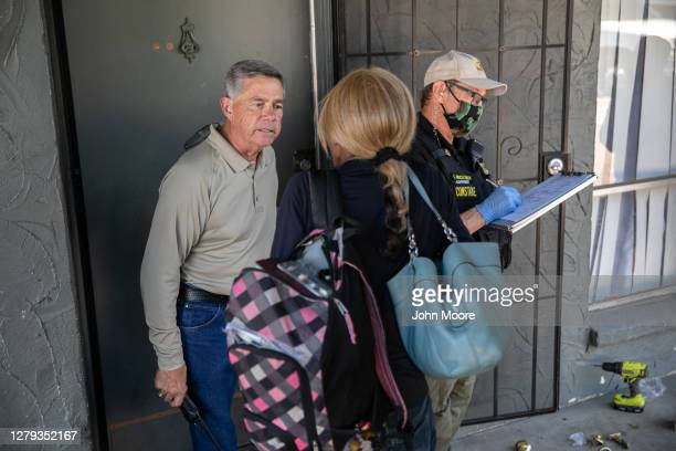 Maricopa County presiding constable Mike Branham speaks with a renter after evicting her from a hotel for non-payment on October 2, 2020 in Phoenix,...