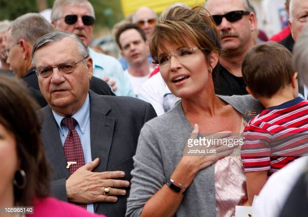 Maricopa County Sheriff Joe Arpaio and Politician and conservative activist Sarah Palin with her son Trig Palin listen to the National Anthem during...