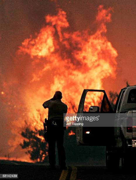Maricopa County Sheriffs Possee member Bob Denny observes and takes a photo of the Carefree Complex fire in the Tonto National Forest along the...
