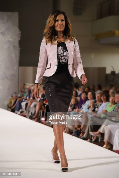 Marie Amiere walks the runway during the Winter/Autumn Fashion Show 'Breaking The Ice' of Liz Malraux on August 2 2018 in Hamburg Germany
