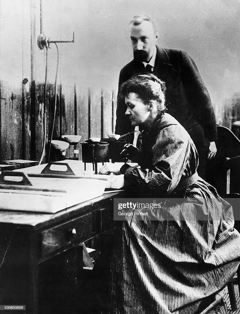 Marie and Pierre Curie in Laboratory : News Photo
