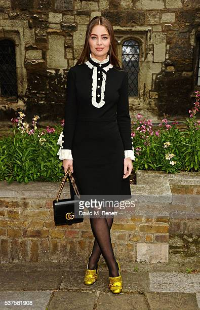 Marie Ange Casta attends the Gucci Cruise 2017 fashion show at the Cloisters of Westminster Abbey on June 2 2016 in London England