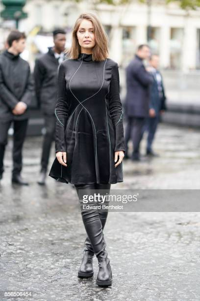 3384c4a8fc47 Marie Ange Casta wears a black dress black thigh high boots and attends Le  Defile L