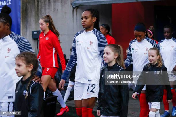 Marie Antoinette Katoto of France and other players enter on the pitch without holding hands to the escort kids due to the Coronavirus COVID19...