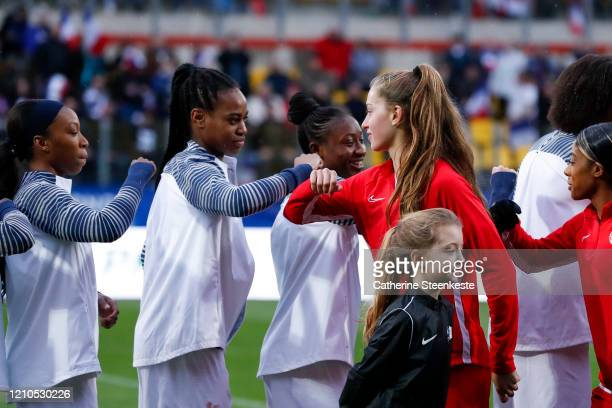 Marie Antoinette Katoto of France elbows instead of shaking hands to Jordyn Huitema of Canada due to the Coronavirus COVID19 epidemic new regulations...
