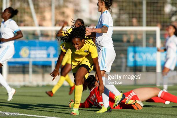 Marie Antoinette Katoto of Paris celebrates scoring during the women's Division 1 match between Marseille and Paris Saint Germain on November 18 2017...