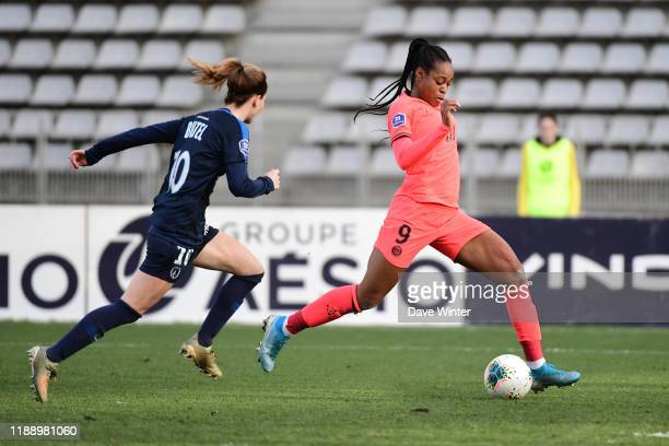 Marie Antoinette KATOTO of PSG and Anaig BUTEL of Paris FC during the Division 1 match between Paris FC and Paris SaintGermain on December 15 2019 in...