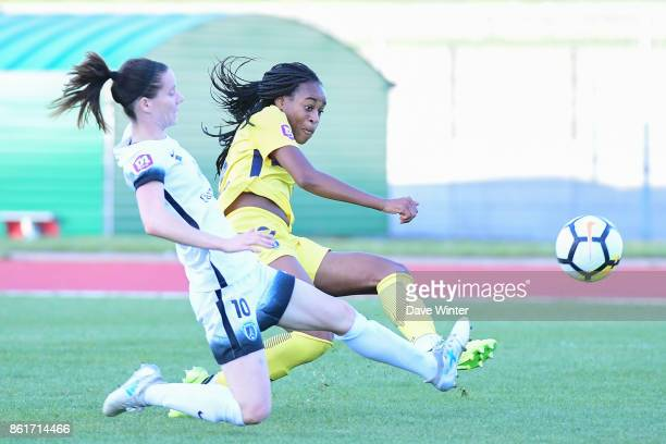 Marie Antoinette Katoto of PSG and Anaig Butel of Paris FC during the women's Division 1 match between Paris FC and Paris Saint Germain on October 15...