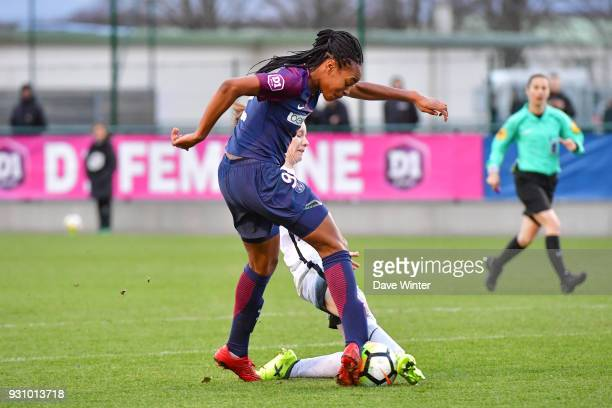 Marie Antoinette Katoto of PSG and Anaig Butel of Paris FC during the Women's Division 1 match between Paris Saint Germain and Paris FC on March 12...