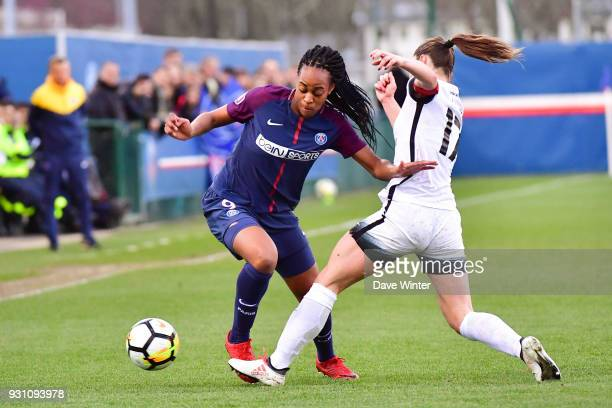 Marie Antoinette Katoto of PSG and Gaetane Thiney of Paris FC during the Women's Division 1 match between Paris Saint Germain and Paris FC on March...