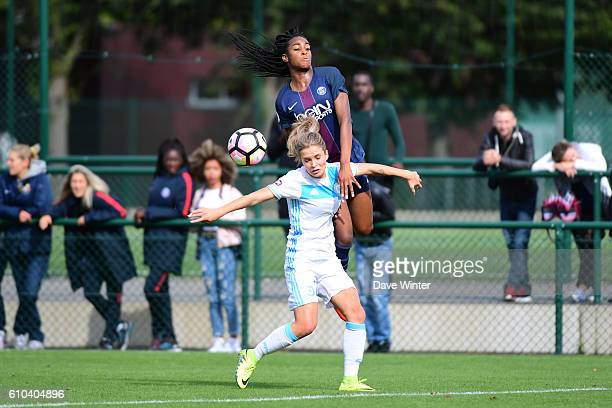 Marie Antoinette Katoto of PSG and Tess Laplacette of Marseille during the women's French D1 league match between PSG and Olympique de Marseille at...