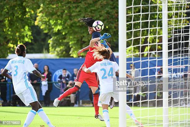 Marie Antoinette Katoto of PSG has a goal disallowed for a foul on goalkeeper Pauline Peyraud Magnin of Marseille during the women's French D1 league...