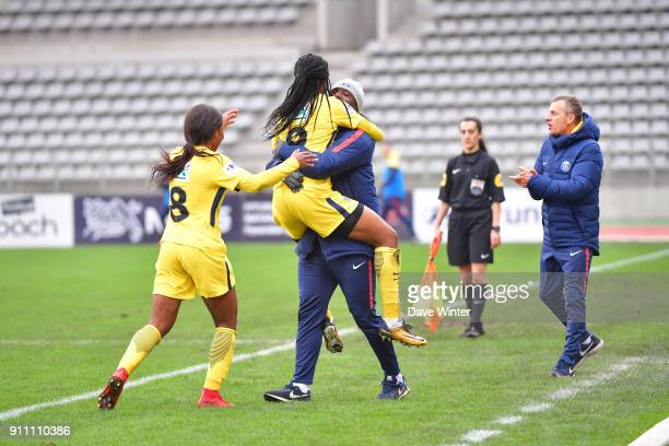 Marie Antoinette Katoto of PSG jumps into the arms of PSG assistant coach Bernard Mendy after putting their side 20 ahead during the Women's National...