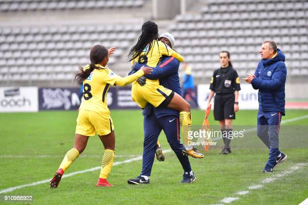Marie Antoinette Katoto of PSG leaps into the arms of PSG assistant coach Bernard Mendy after putting her side 20 ahead during the Women's National...