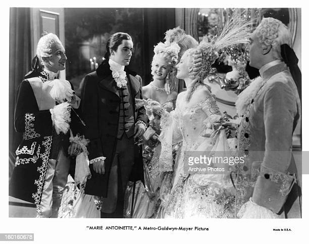 Marie Antoinette looking over at Norma Shearer in a scene from the film 'Marie Antoinette' 1938