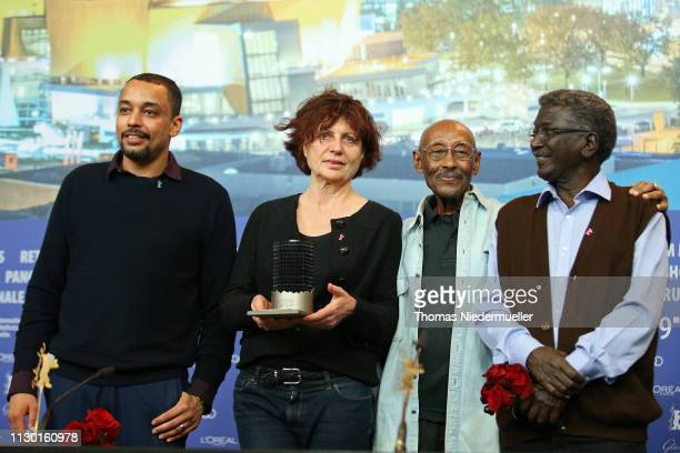 Marie Balducchi and Suhaib Gasmelbari winner of the Glashütte Original Documentary Award for 'Talking About Trees' with protagonists of the film at...