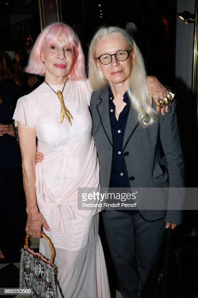 Marie Beltrami and Dominique Issermann attend the Tan Giudicelli Exhibition of drawings and accessories preview at Galerie Pierre Passebon on June 28...