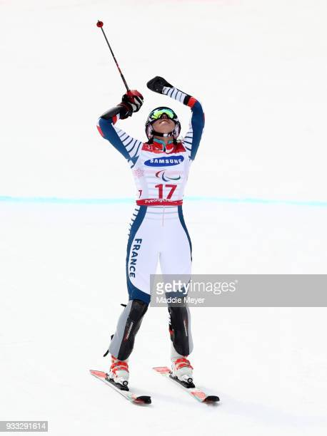 Marie Bochet of France celebrates after winning the gold medal in the Women's Standing Slalom at Jeongseon Alpine Centre on Day 9 of the PyeongChang...