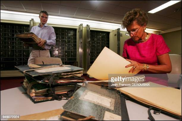 Marie born Tascher de la Pagerie with son Audoin in the vault of her bank looking at the family archives