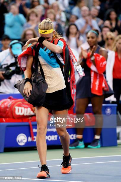 Marie Bouzkova leaves the field as Serena Williams and the crowd applaud after losing her semifinals match of the Rogers Cup tennis tournament on...