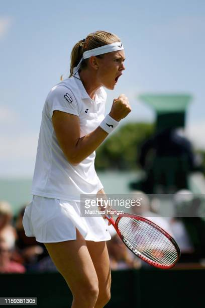 Marie Bouzkova of Czech Republic celebrates a point during the Ladies' Singles first round match against Mona Barthel of Germany during Day one of...