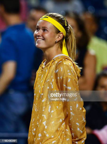 Marie Bouzkova of Czech Republic is all smiles after realizing she is in the semifinals after Simona Halep of Romania retired with a left ankle...