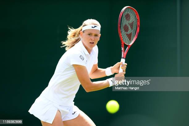 Marie Bouzkova of Czech Republic plays a backhand in her Ladies' Singles first round match against Mona Barthel of Germany during Day one of The...