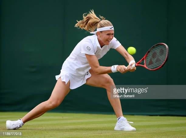 Marie Bouzkova of Czech Republic plays a backhand in her Ladies' Singles second round match against Maria Sakkari of Greece during Day three of The...