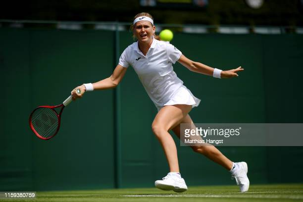 Marie Bouzkova of Czech Republic plays a forehand during the Ladies' Singles first round match against Mona Barthel of Germany during Day one of The...