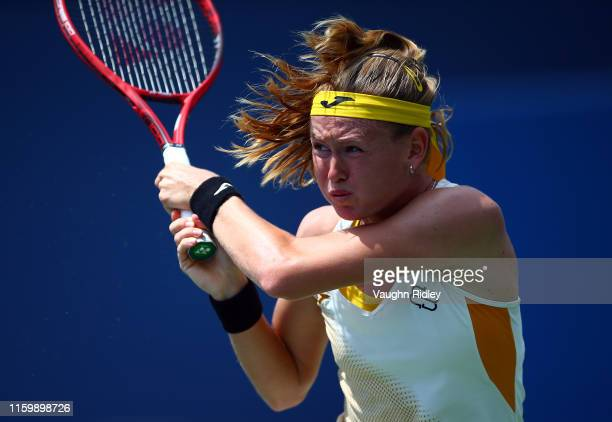 Marie Bouzkova of Czech Republic plays a shot against Leylah Fernandez of Canada during a first round match on Day 3 of the Rogers Cup at Aviva...