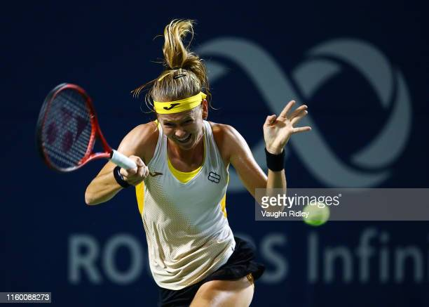 Marie Bouzkova of Czech Republic plays a shot against Sloane Stephens of the United States in a second round match on Day 4 of the Rogers Cup at...