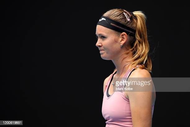 Marie Bouzkova of Czech Republic reacts during her Women's Singles first round match against Naomi Osaka of Japan on day one of the 2020 Australian...