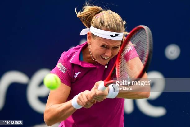 Marie Bouzkova of Czech Republicreturns the ball during the round of 16 between Anna Karolína Schmiedlová of Slovakia and Marie Bouzkova of Czech...