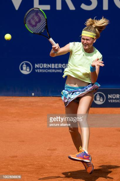 Marie Bouzkova of the Czech Republic in action against Germany's Tatjana Maria during their first round match at the WTAtennis tournament...